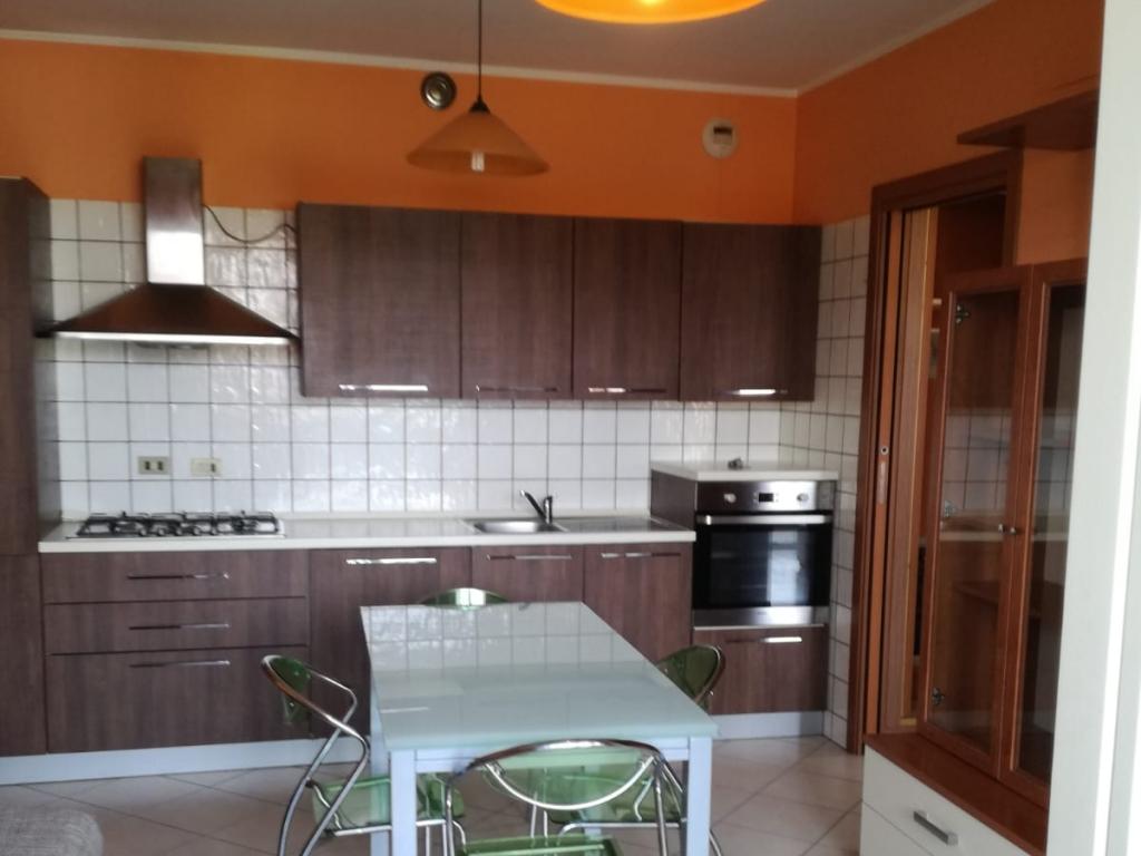 zona soggiorno con cucina